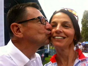 Snagging a Kiss from Renowned Cycling Commentator Paul Sherwin