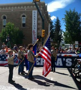 The Boy Scout Color Guard of Gunnison Salutes the National Anthem