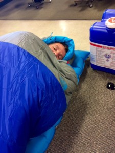 Steve Trying Out a Sleeping Bag at REI